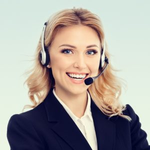 Portrait of happy smiling young support phone operator or businesswomen in headset
