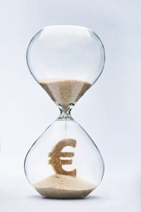 Time is money concept with falling sand taking the shape of a euro