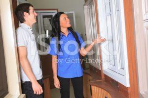 stock-photo-20614268-hardware-employee-show-window